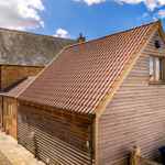 Barn Style Dwelling on farm - using slate, clay pantiles, timber cladding and brickwork in Flemish Bond.